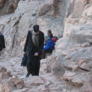 17605-Orthodox_priest_walking_up_Mount_Sinai_gypt